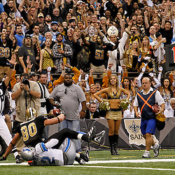 January 7, 2012; New Orleans, LA, USA; New Orleans Saints tight end Jimmy Graham (80) catches a pass over Detroit Lions safety Amari Spievey (42) during the 2011 NFC wild card playoff game at the Mercedes-Benz Superdome. Mandatory Credit: Derick E. Hingle-US PRESSWIRE