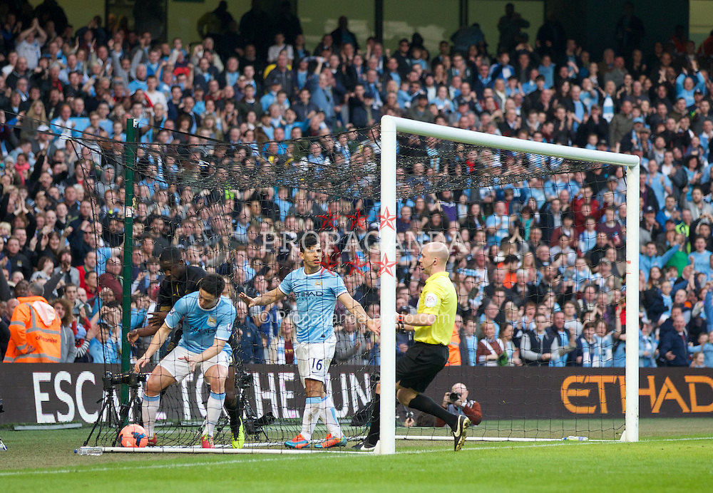 MANCHESTER, ENGLAND - Sunday, March 9, 2014: Manchester City's goalscorer Samir Nasri picks the ball out of the net against Wigan Athletic during the FA Cup Quarter-Final match at the City of Manchester Stadium. (Pic by David Rawcliffe/Propaganda)