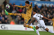 Dele Alli of Tottenham Hotspur gets to the ball ahead of Kyle Naughton of Swansea city .Premier league match, Swansea city v Tottenham Hotspur  at the Liberty Stadium in Swansea, South Wales on Wednesday 5th April 2017.<br /> pic by Andrew Orchard, Andrew Orchard sports photography.