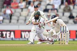 South Africa's Hashim Amla plays a reverse sweep during day four of the Fourth Investec Test at Emirates Old Trafford, Manchester.