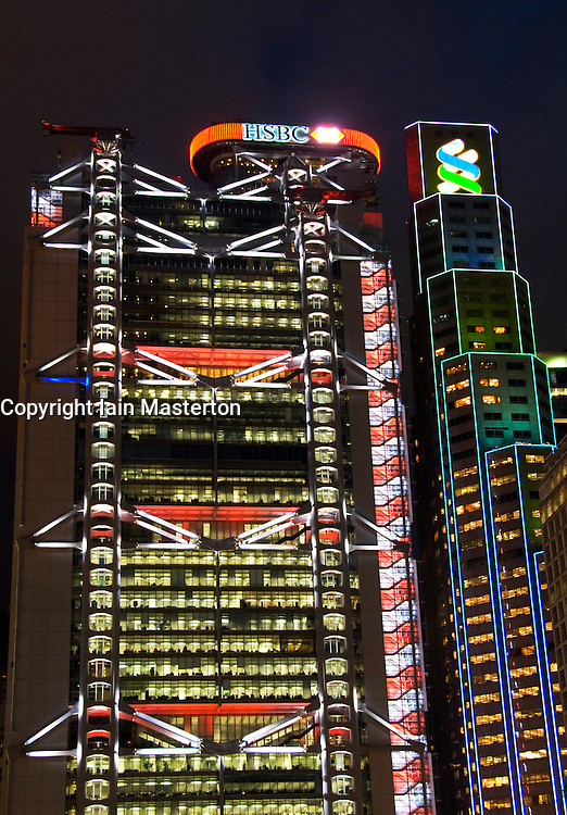 Night view of headquarters of HSBC bank and Standard Chartered Bank in Central district of Hong Kong China