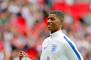 England Forward Marcus Rashford warms up before kick off during the FIFA World Cup Qualifier match between England and Malta at Wembley Stadium, London, England on 8 October 2016. Photo by Andy Walter.