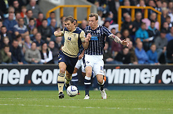 Millwall's Martyn Woolford vies for possession with Leeds United's Stephen Warnock - Photo mandatory by-line: Robin White/JMP - Tel: Mobile: 07966 386802 28/09/2013 - SPORT - FOOTBALL - The Den - Millwall - Millwall V Leeds United - Sky Bet Championship