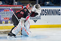 KELOWNA, BC - JANUARY 16: Brodan Salmond #30 of the Moose Jaw Warriors makes a glove save warming up against the Kelowna Rockets at Prospera Place on January 16, 2019 in Kelowna, Canada. (Photo by Marissa Baecker/Getty Images)