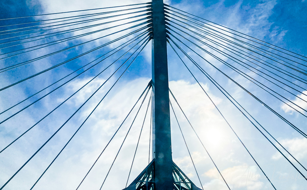 Abstract of the Esplanade Riel bridge against a bright blue sky in downtown Winnipeg, Manitoba