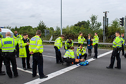 © Licensed to London News Pictures. 13/09/2021. Staines, UK. Police officers surround the last protester as climate campaign group 'Insulate Britain', an offshoot of Extinction Rebellion (XR), block the clockwise slip road at Poyle Interchange/junction 14, M25 London Orbital Motorway. Photo credit: Peter Manning/LNP