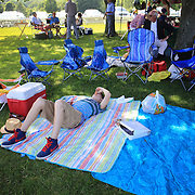 A youngster relaxes in the picnic during the Airstream vs. Cinque Terre Polo match at the Greenwich Polo Club, Greenwich, Connecticut, USA. 23rd June 2013. Photo Tim Clayton