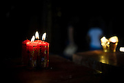 Some candles are seen in a Buddhist temple in Pingyao, China, July 29, 2014.<br /> <br /> Confucianism, Taoism and Buddhism are the three major religions in China. Temples and statues witness their ancient roots all over the Chinese country.<br /> <br /> © Giorgio Perottino