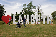 Families with giant letters across the grass in Brockwell Park in Herne Hill, SE24, spelling Lambeth, the largest in area, of London boroughs. The letters are a remnant of the Lambeth Country Show, an annual iner-city weekend festival featuring local businesses and entertainment, it celebrates the successes of Lambeth's achivevements for its population of approximately 303,000.