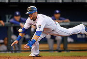 Kansas City Royals' Alex Gordon races the ball into home plate to score in the fourth inning of a baseball game against the Los Angeles Dodgers at Kauffman Stadium in Kansas City, Mo., Wednesday, June 25, 2014.  (AP Photo/Colin E. Braley)
