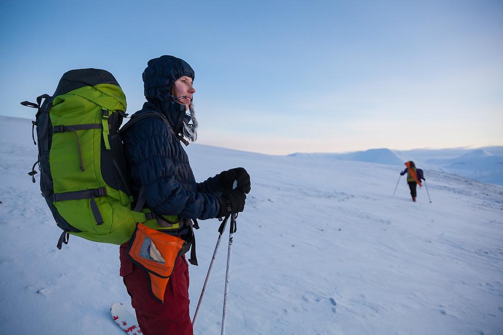 Michelle Blade (left) and Mylène Jacquemart at dusk on a small plateau in Koslådalen, Svalbard.