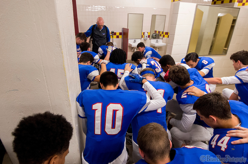 The Christian Brothers Falcons pray inside the locker room before the Sac-Joaquin Section Division I football playoff game between the Christian Brothers Falcons and Cordova Lancers at Huges Stadium,  Friday Nov 11, 2016.<br /> photo by Brian Baer