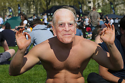 © Licensed to London News Pictures. 20/04/2019. London, UK. A man wearing Prince Philip face mask as thousands of revellers gather in London's Hyde Park as part of '4/20 Day', an unofficial International Weed Day, an event that takes place every year on 20 April for people to smoke cannabis without been detained. Attendees are calling on the Government to decriminalise Class B drug and raise awareness about the drug. Photo credit: Dinendra Haria/LNP