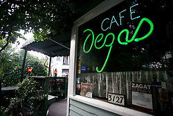 11june 2010. New Orleans, Louisiana. <br /> Cafe Degas and owner Jaques Soula continue to offer the highest quality seafood at his restaurant on Esplanade Ave. Worries persist as fish stocks run low and prices rise thanks to closed fishing grounds affected by oil pollution. BP's disastrous environmental catastrophe out in the Gulf of Mexico threatens  the livelihood of many thousands of workers affiliated to the fishing industry in Louisiana. Thousands of barrels of oil per day continues to leak into the Gulf because of the explosion and collapse of the Deepwater Horizon drilling platform 46 miles out to sea. The closure of fishing grounds both east and west of the Mississippi river outflow is crippling thousands of local fishermen and all affiliated businesses and families who rely on the seafood industry.  <br /> Photo; Charlie Varley/varleypix.com