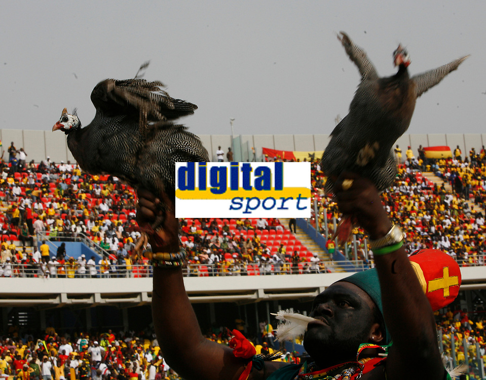 Photo: Steve Bond/Richard Lane Photography.<br />Ghana v Guinea. Africa Cup of Nations. 20/01/2008. Guinea fowl in trouble