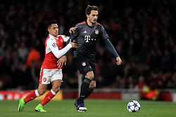 Arsenal's Alexis Sanchez (left) and Bayern Munich's Mats Hummels battle for the ball
