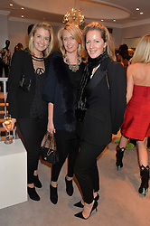Left to right, LIZ McNAMARA, ARABELLA DUNN and JULIET FETHERSTONHAUGH at a party at Herve Leger, Lowndes Street, London on 12th November 2014 to view the latest collection.