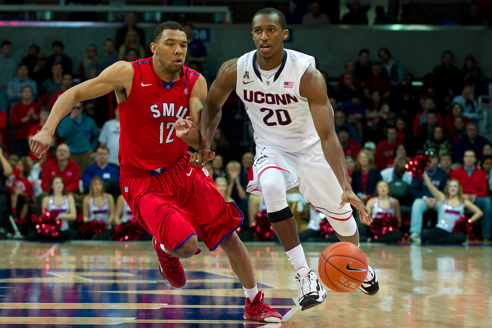 DALLAS, TX - JANUARY 4: Lasan Kromah #20 of the Connecticut Huskies brings the ball up court against the SMU Mustangs on January 4, 2014 at Moody Coliseum in Dallas, Texas.  (Photo by Cooper Neill) *** Local Caption *** Lasan Kromah