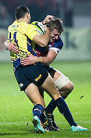 Louis Stanfill (L) of USAtries to stop Robert Neagu (L) of Romania  during their  rugby test match between Romania and USA, on National Stadium Arc de Triomphe in Bucharest, November 8, 2014.  Romania lose the match against USA, final score 17-27.