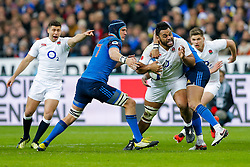 England Number 8 Billy Vunipola is tackled by France Flanker Bernard Le Roux and Outside Centre Gael Fickou - Mandatory byline: Rogan Thomson/JMP - 19/03/2016 - RUGBY UNION - Stade de France - Paris, France - France v England - RBS 6 Nations 2016.