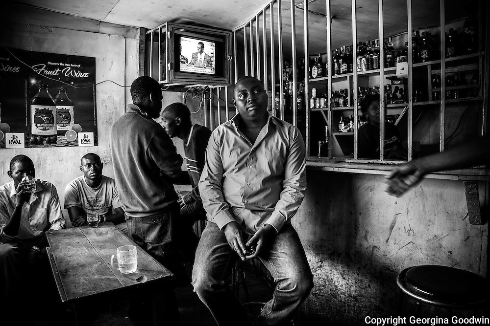 Mark Mutungi, owner of pubs 'Mark1' and 'Mark2' on Mugumoini's main road Kitengela Street. Pubs and bars such as these provide places for the community's men without work or prospects to find solace in alcohol. The two pubs are serviced by women and are often the breeding grounds from where rape and violence take place.<br /> This image is from a series focusing on and around the rape and the women victims that occur every half a day in Mugumoini Village in Nairobi's Southlands, a slum home to 20,000 people in abject poverty with little or no income, with the aim of creating exposure and empowerment for change. ©GGoodwin