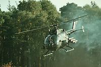 09 OCT 1995, MUNSTER/GERMANY:<br /> Panzerabwehrhubschrauber 1 BO-105 P der Bundeswehr, während einer Lehrvorführung der Panzertruppenschule Munster<br /> Anti-tank defense helicopter Panzerabwehrhubschrauber 1 BO-105 P of the German Federal Armed Forces, during a trainig performance<br /> IMAGE: 19951009-01/07-35<br />  <br />  <br />  <br /> KEYWORDS: Streikräfte, army, Waffen, wappon, Hubschrauber