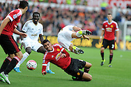 Swansea city's Jack Cork is upended by a strong tackle from Chris Smalling of Man Utd. Barclays Premier League match, Swansea city v Manchester Utd at the Liberty Stadium in Swansea, South Wales on Sunday 30th August  2015.<br /> pic by Andrew Orchard, Andrew Orchard sports photography.