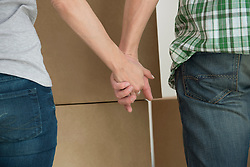Close-up couple holding hands new home
