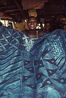 vendor with indigo cloths, Ibadan, Nigeria- Photograph by Owen Franken