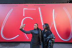 © Licensed to London News Pictures. 15/02/2019. LONDON, UK. Followers of fashion take a selfie outside the British Fashion Council space at 180 The Strand on the opening day of London Fashion Week.  Designers from around the world will be showing their Autumn and Winter (AW19) creations at a variety of venues in the capital.  Photo credit: Stephen Chung/LNP