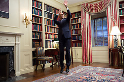 President Barack Obama feigns a jump shot during an Affordable Care Act video taping for BuzzFeed in the White House Library, Feb. 10, 2015. (Official White House Photo by Amanda Lucidon)<br /> <br /> This official White House photograph is being made available only for publication by news organizations and/or for personal use printing by the subject(s) of the photograph. The photograph may not be manipulated in any way and may not be used in commercial or political materials, advertisements, emails, products, promotions that in any way suggests approval or endorsement of the President, the First Family, or the White House.