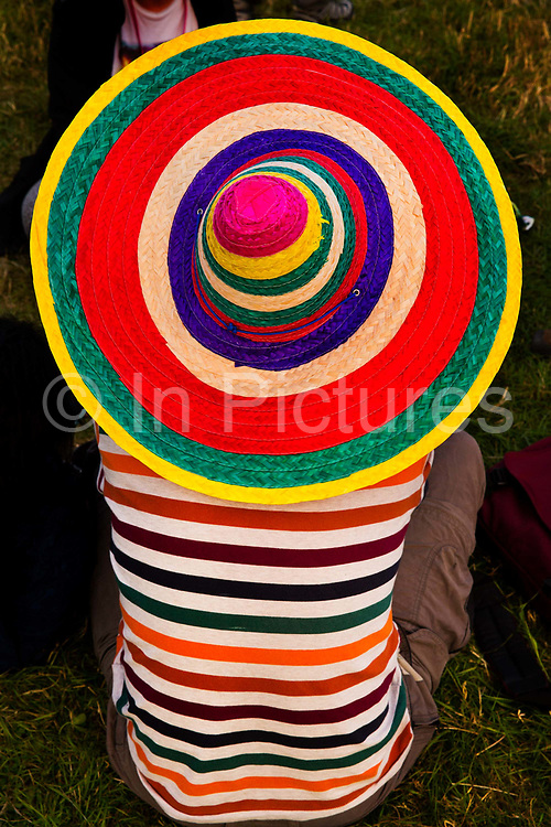 Glastonbury Festival, 2015.<br /> Man with sombrero and stripped T-shirt