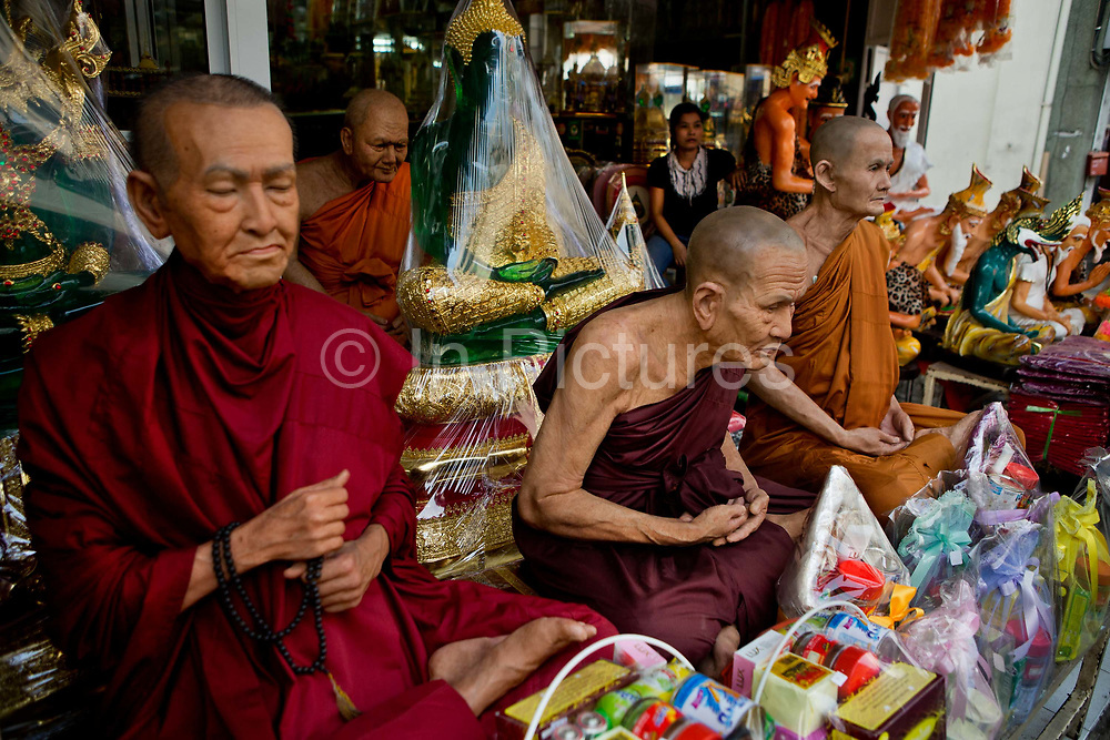 Waxwork statues of revered Buddhist figures for sale. Situated in the heart of Bangkok, near the famous swing, is a series of streets and alleyways dedicated to the manufacture of Buddhist and Hindu icons together with other religious paraphernalia.