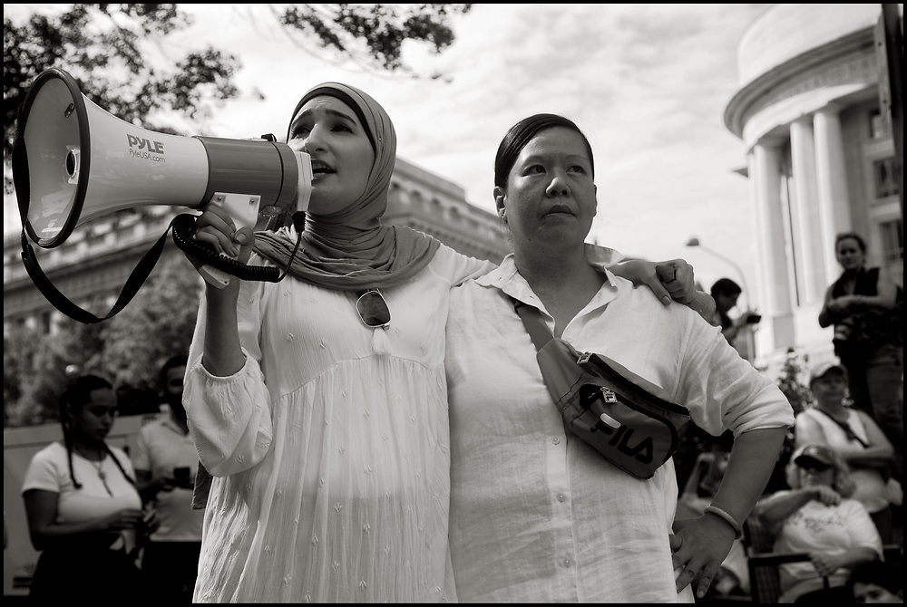 """On June 28, 2018 more than one thousand women from all over the US marched from the Freedom Plaza in Washington, DC, to Capitol Hill for a peaceful protest and sit-in at The Hart Senate Office Building over the Trump administration's """"zero tolerance"""" immigration policy which called for separating children from their parents. At least 575 women were arrested.<br /> <br /> Linda Sarsour and Winnie Wong speak to the crowd before the march to The Hart Senate Building."""