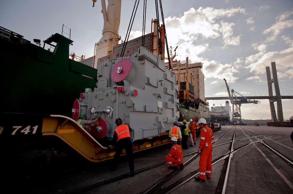 A 79 metric ton transformer is lifted onto a rail car at the Georgia Ports Authority at the Ocean Terminal, Saturday, Sept. 21, 2013, in Savannah, Ga.  (GPA Photo/Stephen Morton)