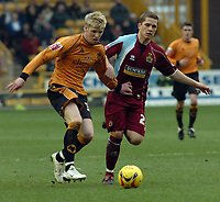 Photo: Kevin Poolman.<br />Wolverhampton Wanderers v Burnley. Coca Cola Championship. 17/02/2007. Andy Keogh of Wolves and Joey Gudjonsson of Burnley fight over the ball.