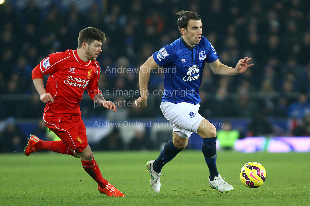 Seamus Coleman of Everton breaks away from Alberto Moreno of Liverpool. Barclays Premier league match, Everton v Liverpool at Goodison Park in Liverpool, Merseyside on Saturday 7th February 2015<br /> pic by Chris Stading, Andrew Orchard sports photography.