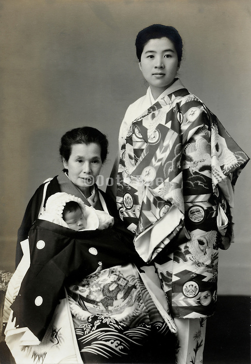 vintage formal portrait of grandmother and mother with new born baby Japan