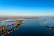 """Nederland, Zuid-Holland, Haringvliet, 07-02-2018; oostelijk deel van het eiland Tiengemeten. Het eiland werd oorspronkelijk gebruikt voor de akkerbouw maar is inmiddels 'teruggegeven aan de natuur', de dijken zijn deels doorgestoken, de laatste boer is in 2006 vertrokken. De 'nieuwe natuur' vormt onderdeel van de Ecologische Hoofdstructuur.<br /> The island Tiengemeten in the Haringvliet, was originally used for agriculture but has now """"been given back to nature"""". Large parts have been flooded and the isle is part of the National Ecological Network. The last farmer left in 2006. Current use, among other, care farm and camping. <br /> luchtfoto (toeslag op standard tarieven);<br /> aerial photo (additional fee required);<br /> copyright foto/photo Siebe Swart"""