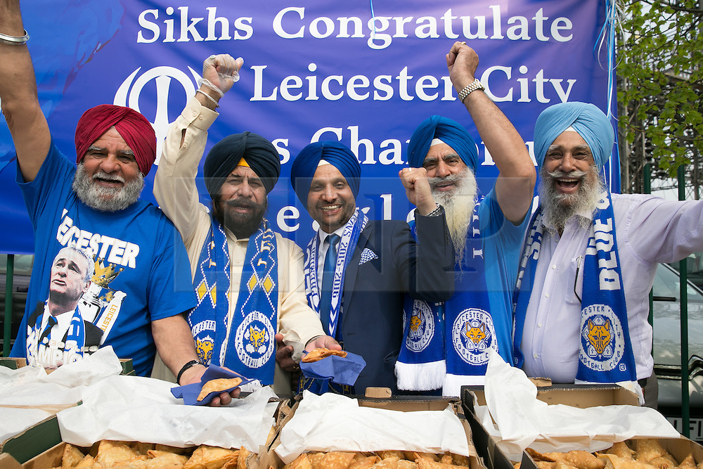 © Licensed to London News Pictures. 07/05/2016. Leicester, UK. Leicester City fans celebrating outside the King Power stadium before their match with Everton before lifting the Premiership trophy. Pictured, Sikhs offering free samosas and cheers outside the stadium. Photo credit: Dave Warren/LNP