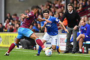 Scunthorpe United defender Jordan Clarke (2) and Portsmouth midfielder Matthew Kennedy (11) during the EFL Sky Bet League 1 match between Scunthorpe United and Portsmouth at Glanford Park, Scunthorpe, England on 23 September 2017. Photo by Ian Lyall.