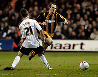 Photo: Leigh Quinnell.<br /> Luton Town v Hull City. Coca Cola Championship. 13/03/2007. Hulls Stuart Elliott jumps a challenge from Lutons Keith Keane.