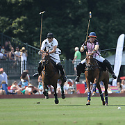 Hilario Ulloa, (left), White Birch and Kris Kampsen, K.I.G.   challenge for the ball during the White Birch Vs K.I.G Polo match in the Butler Handicap Tournament match at the Greenwich Polo Club. White Birch won the game 11-8. Greenwich Polo Club,  Greenwich, Connecticut, USA. 12th July 2015. Photo Tim Clayton