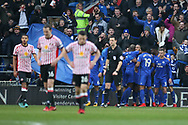 Sunderland players  stand dejected as Cardiff city players celebrate after they score 3rd goal, scored by Callum Paterson of Cardiff. EFL Skybet championship match, Cardiff city v Sunderland at the Cardiff city stadium in Cardiff, South Wales on Saturday 13th January 2018.<br /> pic by Andrew Orchard, Andrew Orchard sports photography.