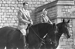 File photo dated 08/06/82 of the then US President Ronald Reagan and Queen Elizabeth II riding in Home Park in Windsor.