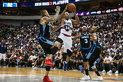 August 17, 2018 - Dallas, TX, U.S. - DALLAS, TX - AUGUST 17: Tri-State David Hawkins #34 drives to the basket surrounded by Power Corey Maggette #50, Quentin Richardson #3 and Chris Andersen #11 during the Big 3 Basketball playoff game between the Power and the Tri-State on August 17, 2018 at the American Airlines Center in Dallas, Texas. Power defeats Tri-State 51-49. (Photo by Matthew Pearce/Icon Sportswire) (Credit Image: © Matthew Pearce/Icon SMI via ZUMA Press)