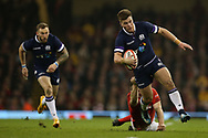 Huw Jones of Scotland ® breaks away from a tackle from Ken Owens of Wales. Wales v Scotland, NatWest 6 nations 2018 championship match at the Principality Stadium in Cardiff , South Wales on Saturday 3rd February 2018.<br /> pic by Andrew Orchard, Andrew Orchard sports photography