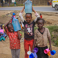Children Collecting Water in Mathare by Felistar Oyolo