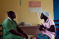 Sudan, May 2009. Intrahealth funded VCT nurse Sarah Mallia counsels Pasqualine Netaungua at the Nimule Hospital. Pasqualine is HIV positive and helped Sarah found the first Nimule HIV support group.
