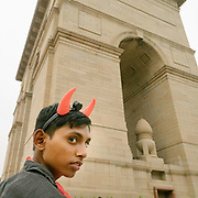 A teenager wearing devils horn at the Gate of India.